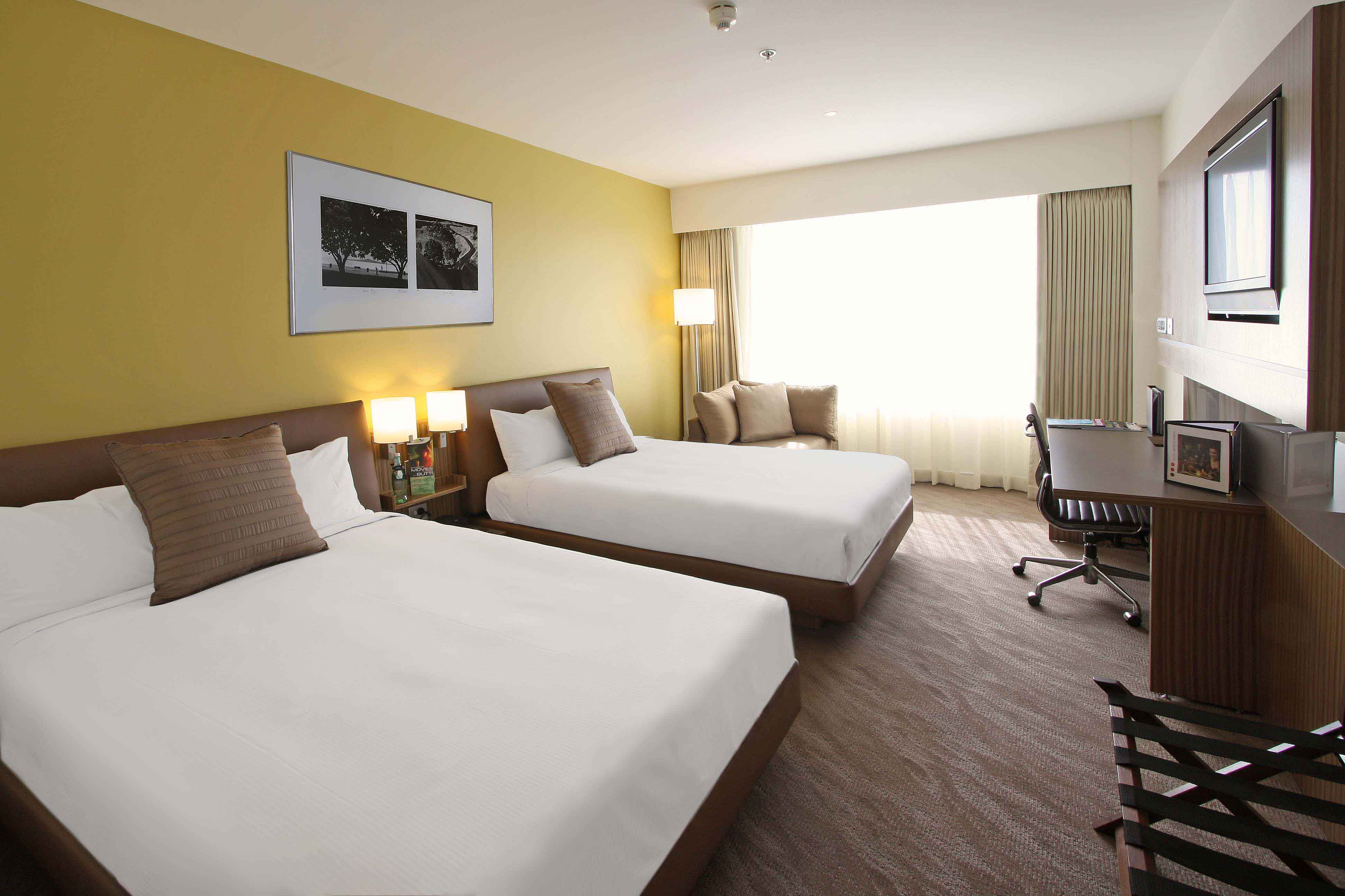 Superior Room with double twin beds. Experience increased connectivity to connect laptops, digital cameras and media players via 32